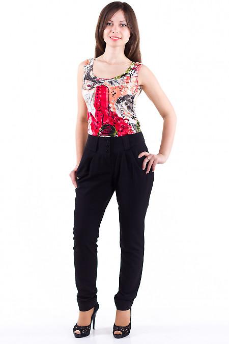 Фото Брюки зауженные с защипами черные Деловая женская одежда