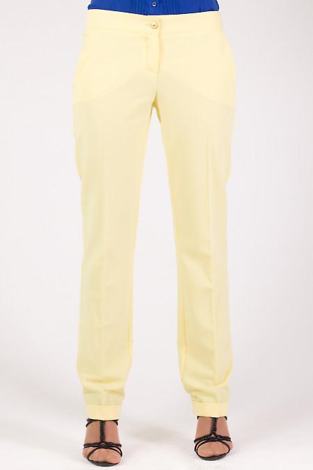 Фото Брюки с манжетами желтые Деловая женская одежда