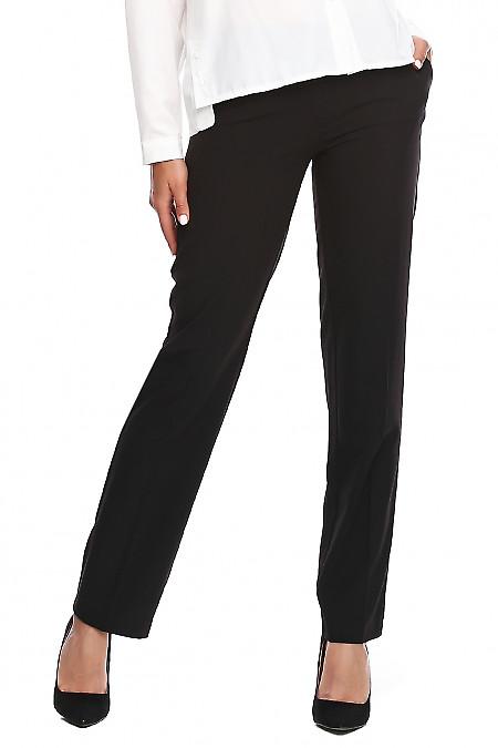 Брюки чёрные с хлястиком. Деловая женская одежда фото