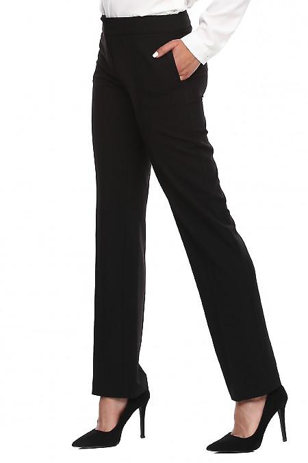 Купить брюки чёрные с хлястиком. Деловая женская одежда фото