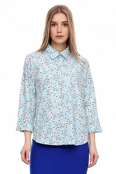 Блузка бирюзовая в цветы со спущенными рукавом. Деловая женская одежда фото