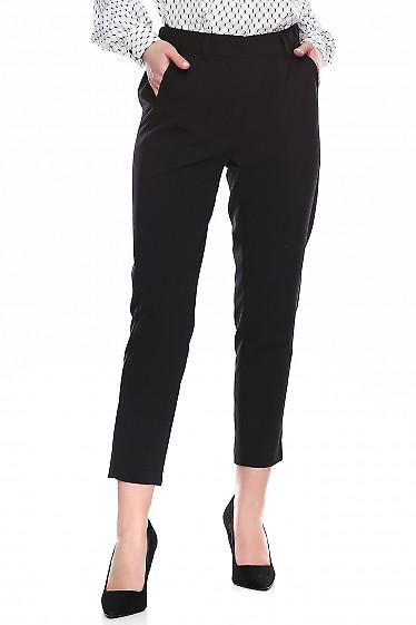Брюки чёрные короткие на резинке. Деловая женская одежда фото